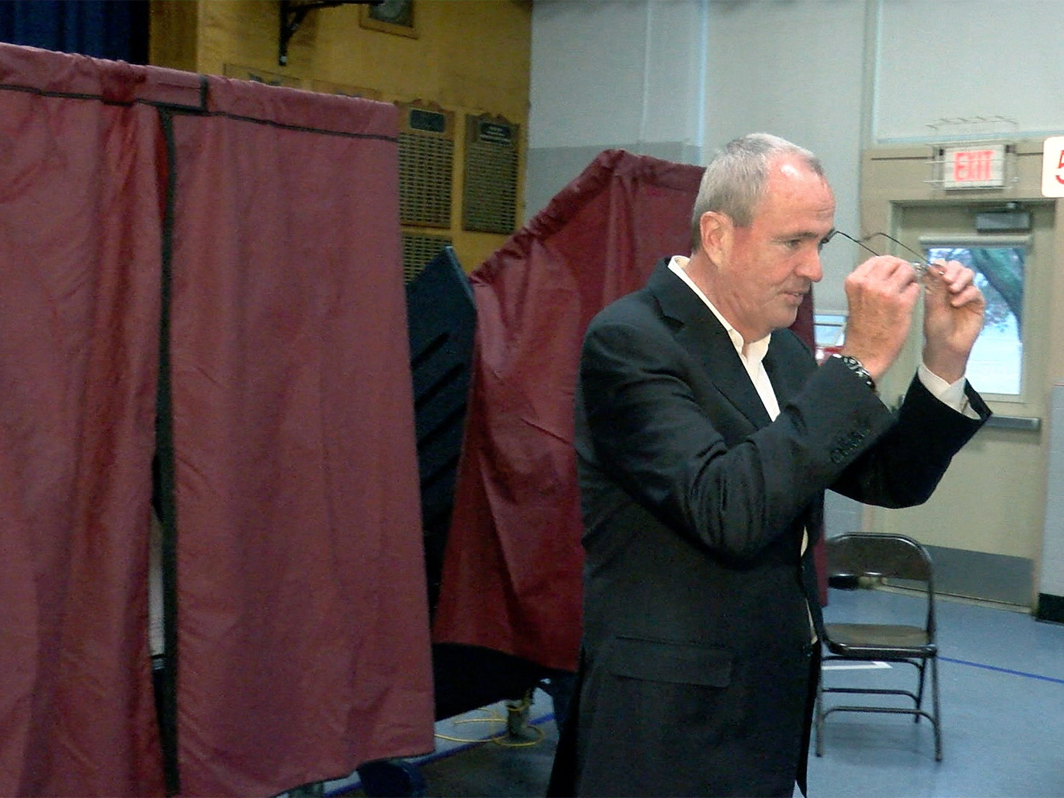 NJ Governor Phil Murphy leaves the booth after voting at the Fairview Elementary School in Middletown Tuesday, November 6, 2018.