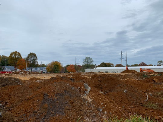 Workers have demolished a Shrewsbury office building to make way for a QuickChek convenience store.