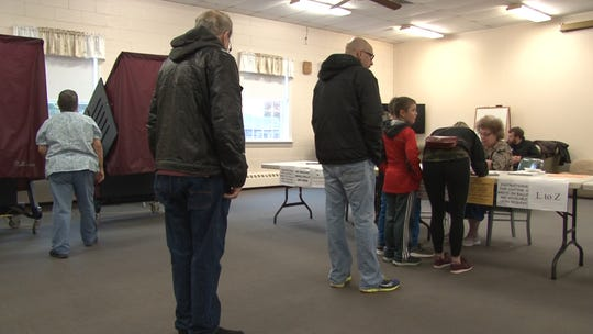 Voters wait in line in Toms River.