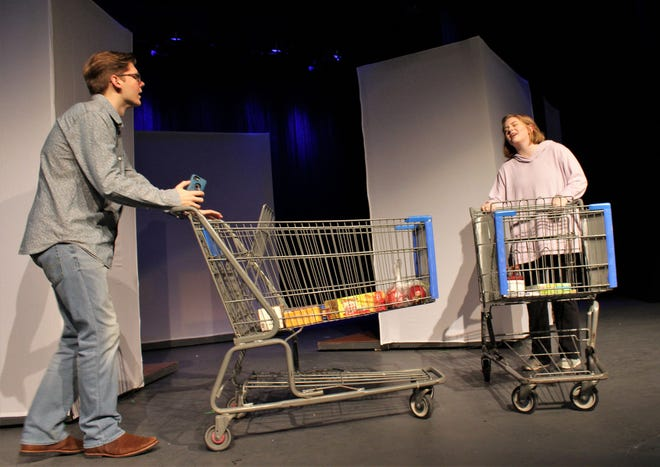 "Jake (Trey Smith) and Emily (Kathryn Darwin bump shopping carts and stammer into an awkward conversation in this rehearsal scene from ""Love/Sick,'' Hardin-Simmons University's student-directed production that continues through Sunday."