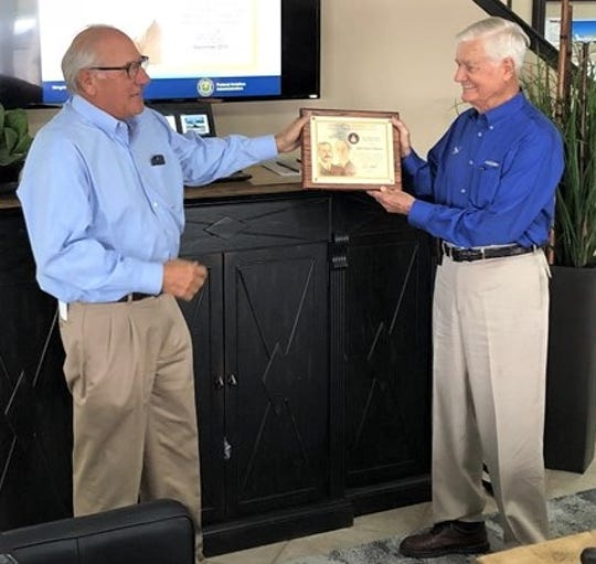LeRoy Bell, left, presented Dr. Jack Ramsey with the Wright Brothers Master Pilot Award in September at Abilene Aero.