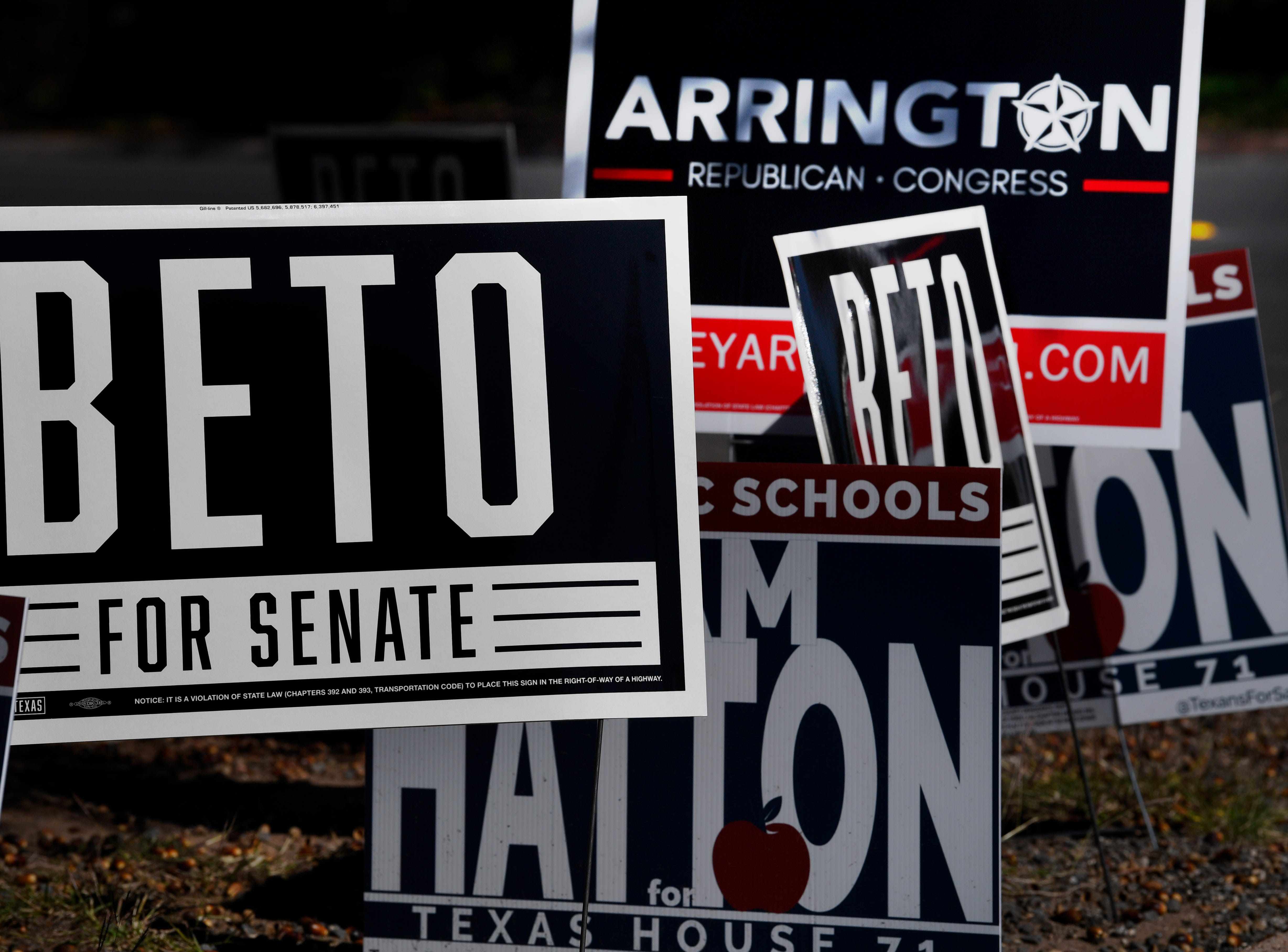 Campaign signs crowd together at a corner on the Taylor County Plaza Tuesday.