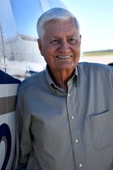 Jack Ramsey stands beside his Piper Navajo airplane Nov. 2. Ramsey, an Abilene doctor, will receive the Big Country Medical Society's Gold Headed Cane Award.