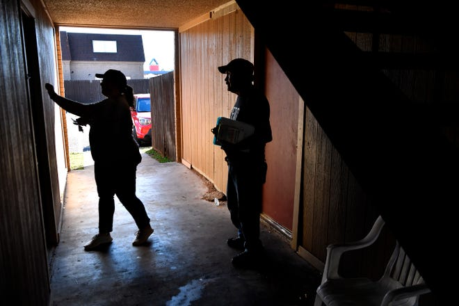 Sarah Carlson and Tony Soliz knock on a door at a south Abilene apartment Tuesday. The pair were block walking for the Beto O'Rourke U.S. Senate campaign.