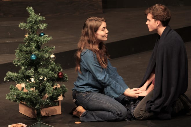 """Jen (Madison Massey) and John (Carl Kimbrough) are sister and brother, in this rehearsal scene by a Christmas tree, in Abilene Christian University's """"John & Jen,"""" which opens a six-night run Monday."""