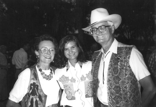 From left: Joy, daughter Lauren and Dr. Jack Ramsey at a 1991 event that required a cowboy hat, string tie and rattlesnake vest.