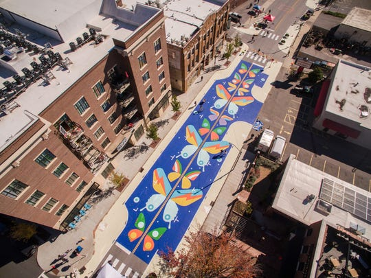 An aerial view of Coxe Avenue in downtown Asheville shows the temporary artwork on the pavement.