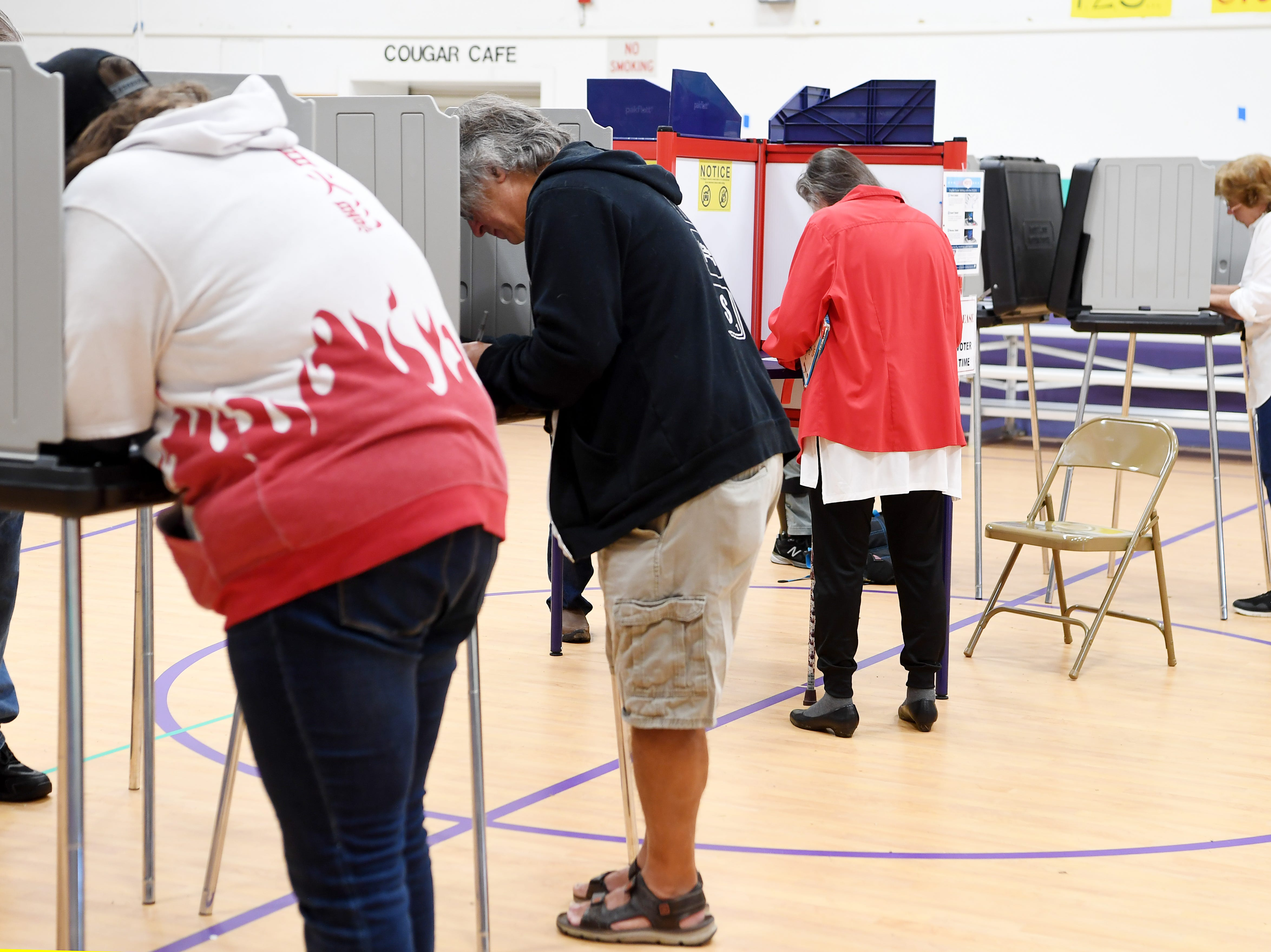 People fill in their ballots at Emma Elementary Nov. 6, 2018.