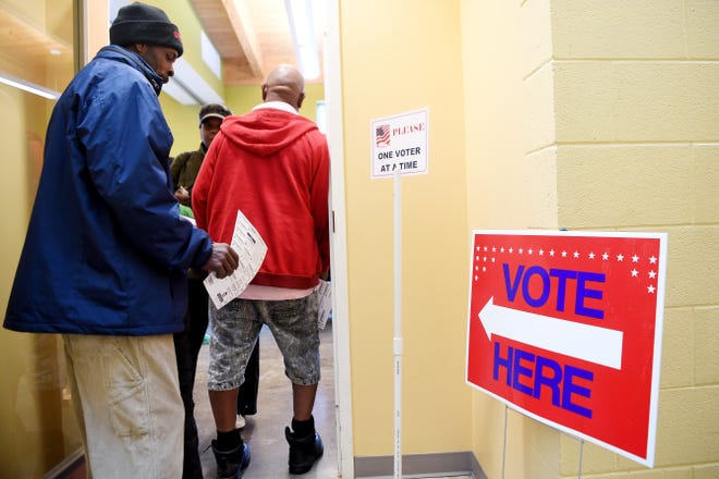 People wait in line to vote at the Dr. Wesley Grant Southside Center Nov. 6, 2018.