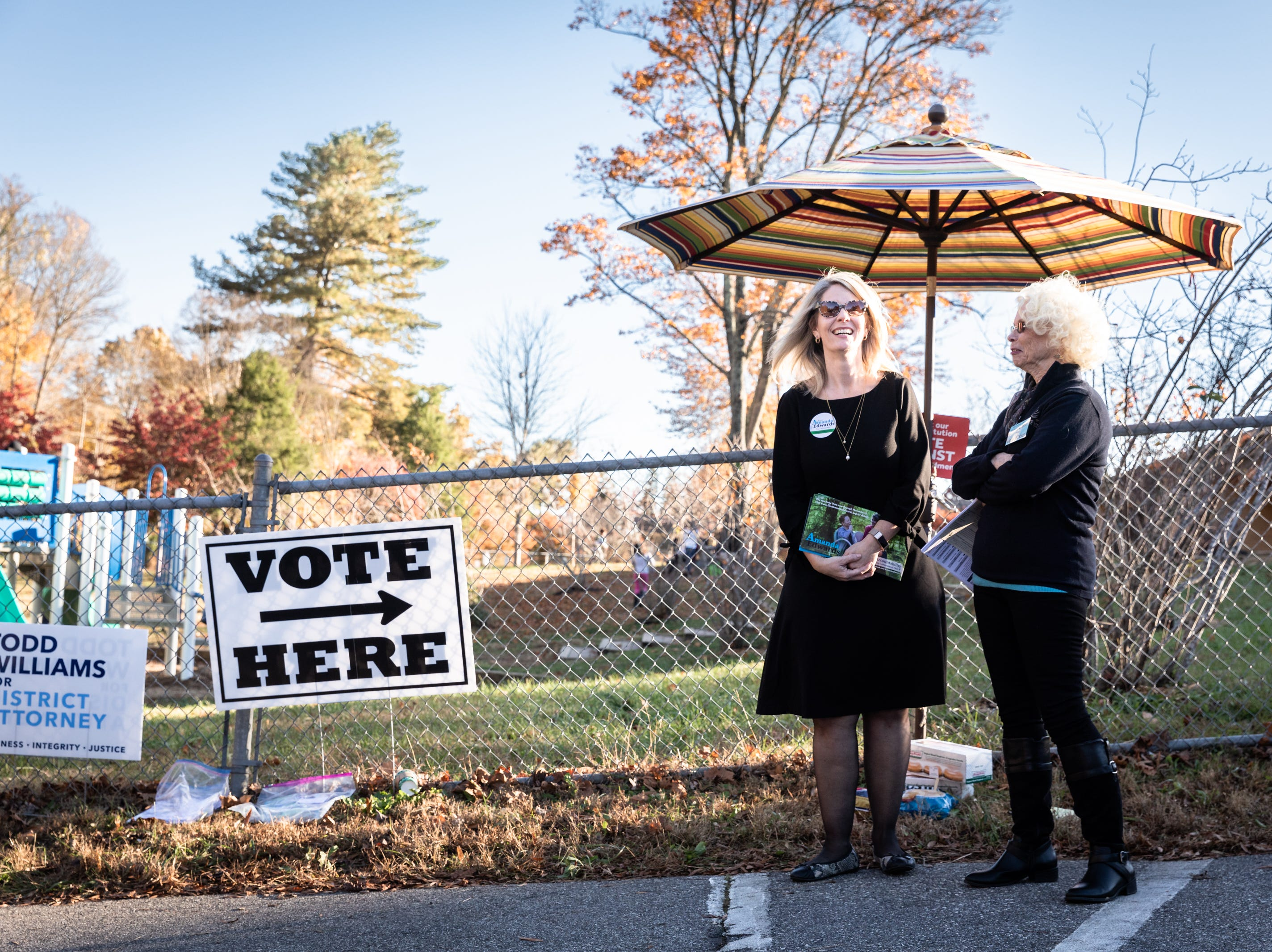 Amanda Edwards, Democratic candidate for the district 2 Buncombe County Commission, talks with Beverly Kimble, a volunteer with the Buncombe county Democratic Party and the precinct chair of 22.2 at Ira B. Jones elementary school, one of the midterm election voting sites, Nov. 6, 2018.
