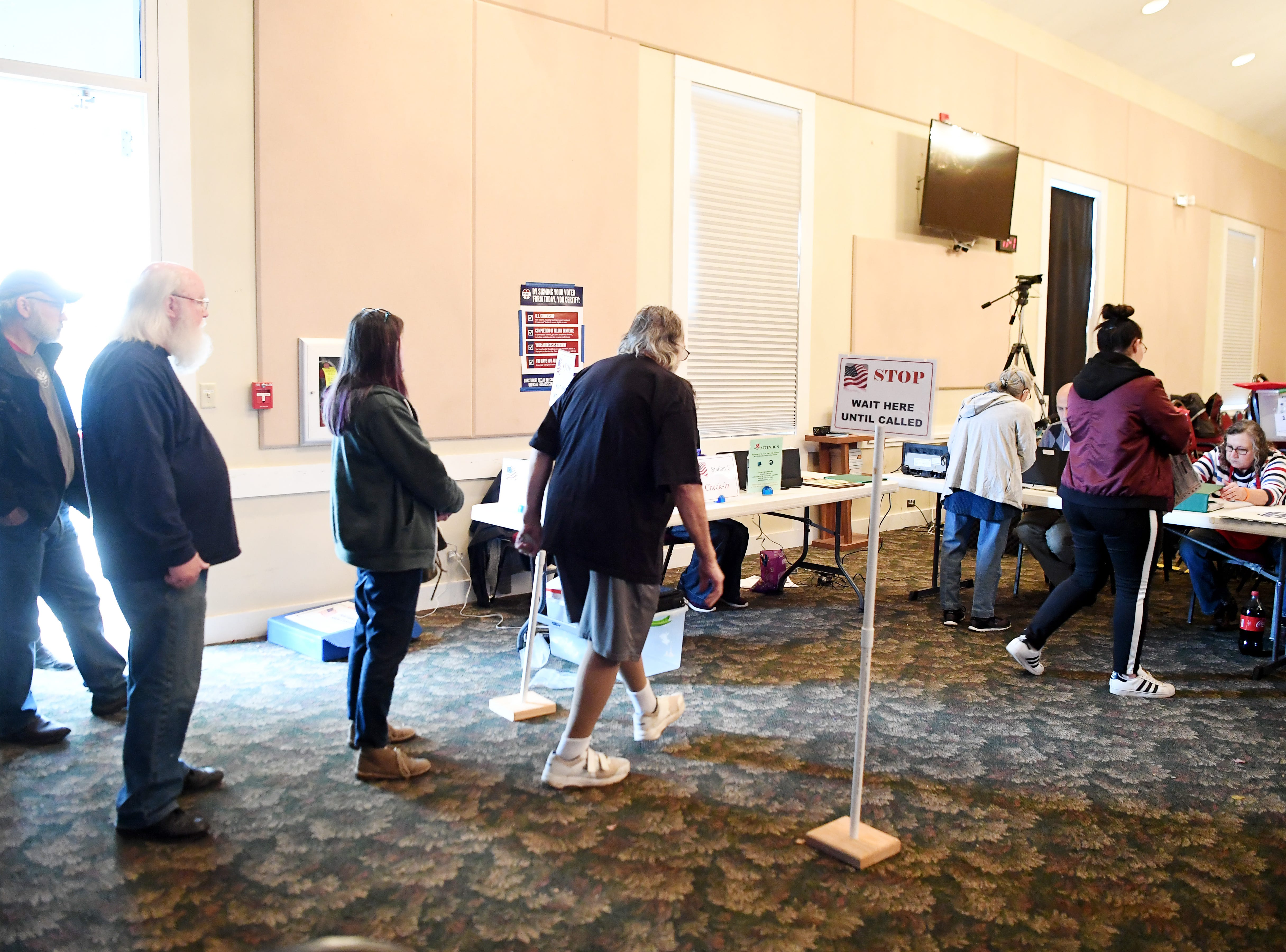 People wait in line to cast their ballots Nov. 6, 2018 at Calvary Baptist.