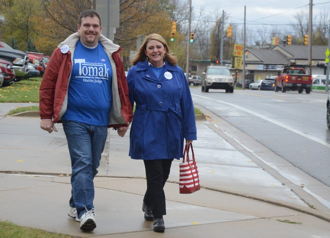 Tracie Tomak and her husband, Jon Galbreath, broke from campaigning Tuesday and attended noon mass at St. Philip Catholic Church.