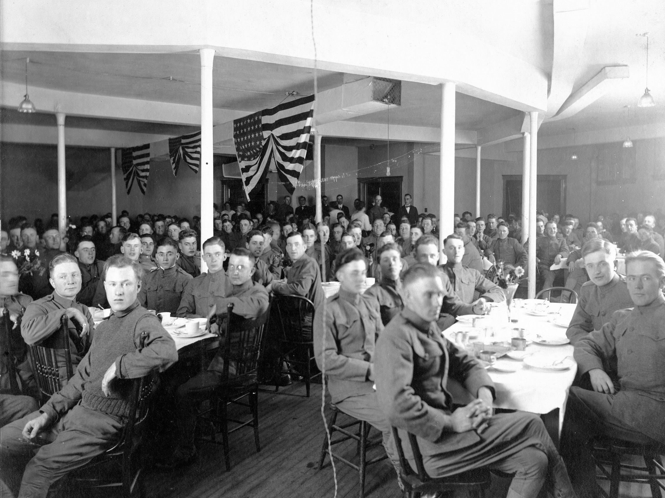 Soldiers having a meal in the First Methodist Church basement dining room during 'The Great War.'
