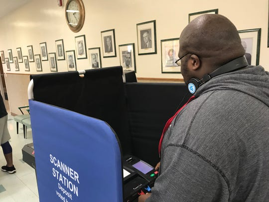 Phillip Devore, 24, of Endicott, casts his vote in the Endicott Municipal building.