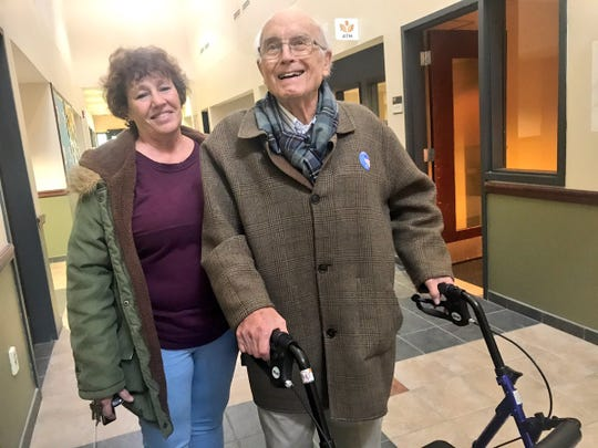 Joseph Dallett, 89, at the polls in Ithaca on Election Day, Nov. 6, 2018. He is accompanied by aide Debra Kaiser.