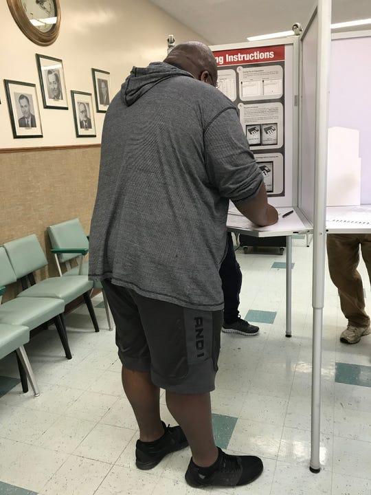Phillip Devore, 24, of Endicott, casts his vote Tuesday.