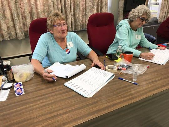 Vilma Byrne, left, and Martha Barker, work as poll inspectors on Election Day in Legislative District 5, in Endicott.