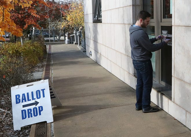 Justin Crane, of Port Orchard, places his ballot into the drop at Kitsap County Administration Building on Tuesday, November 6, 2018.