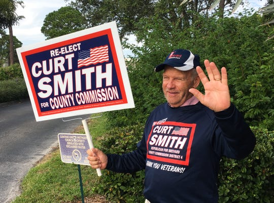 District 4 County Commissioner was waving to motorists from the entrance of Suntree United Methodist Church off of North Wickham Road on Election Day.