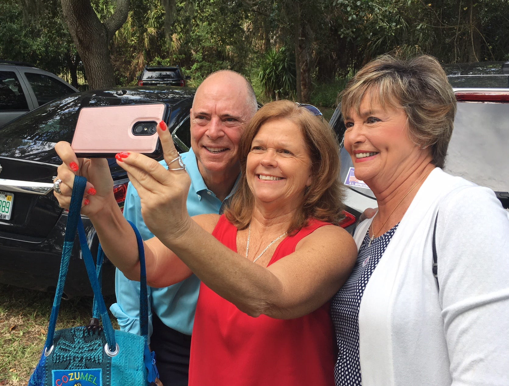 Sabrina Liquori takes a selfie with Congressman Bill and Katie Posey at Cocoa Rockledge Garden Club.