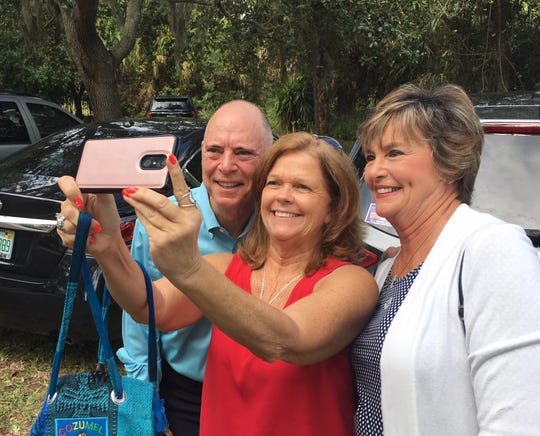 Sabrina Liquori takes a selfie with Rep. Bill Posey and his wife, Katie, at Cocoa Rockledge Garden Club on Election Day.