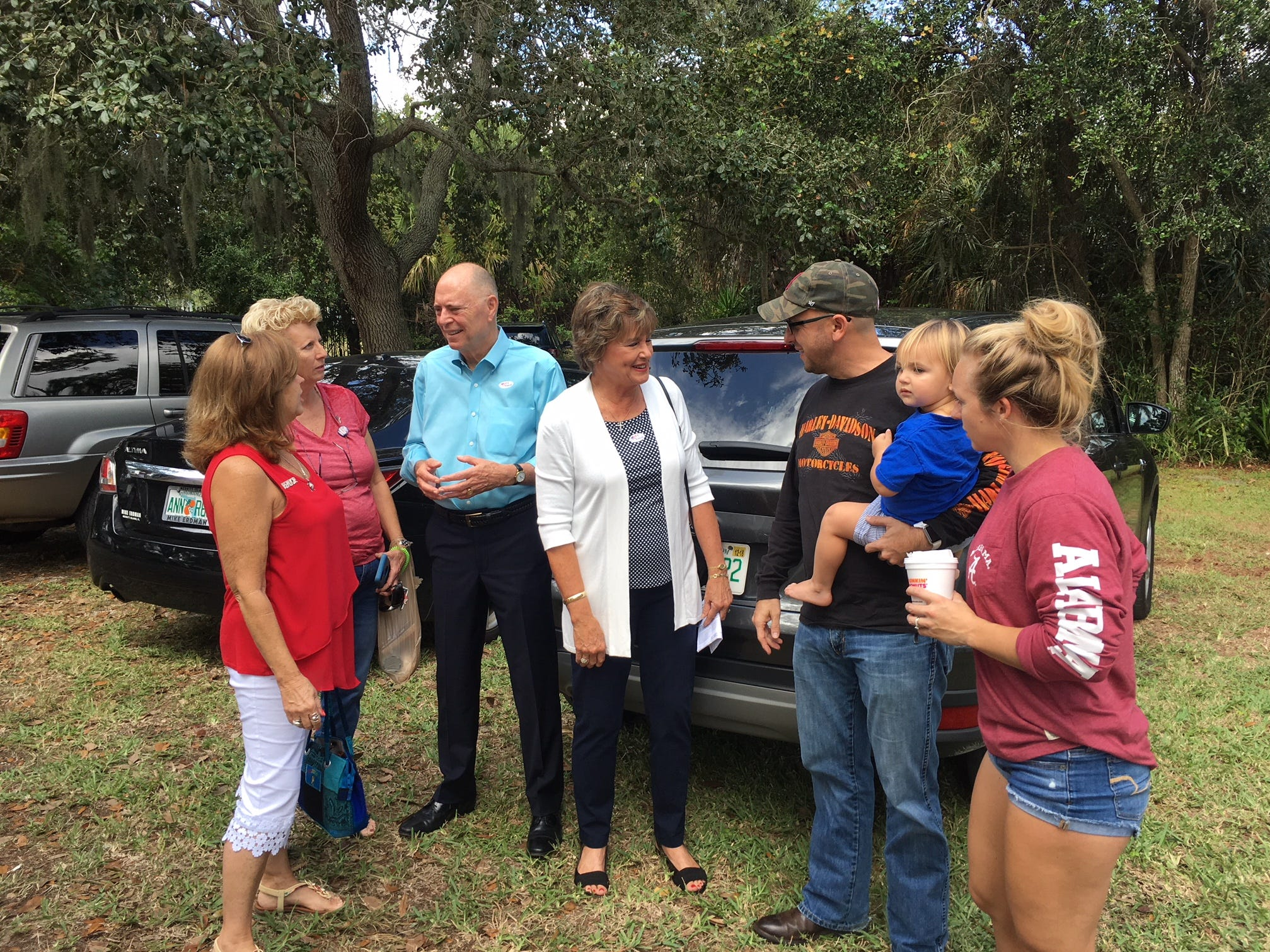 Congressman Bill and Katie Posey draw a crowd of well wishers after voting at Cocoa Rockledge Garden Club.