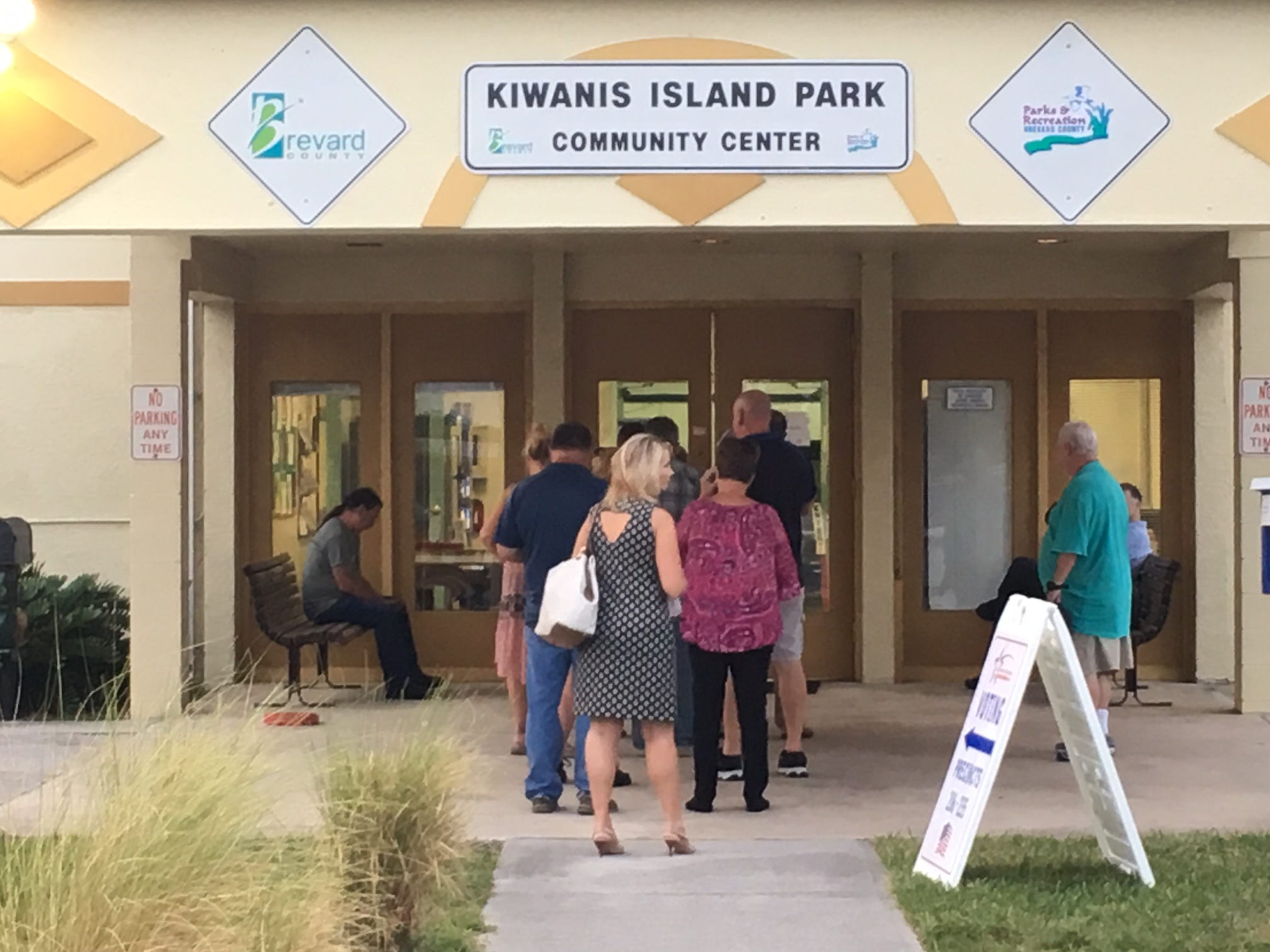 People stand in line before 7 a.m. to vote at Kiwanis Island in the Nov. 6, 2018, midterm election.