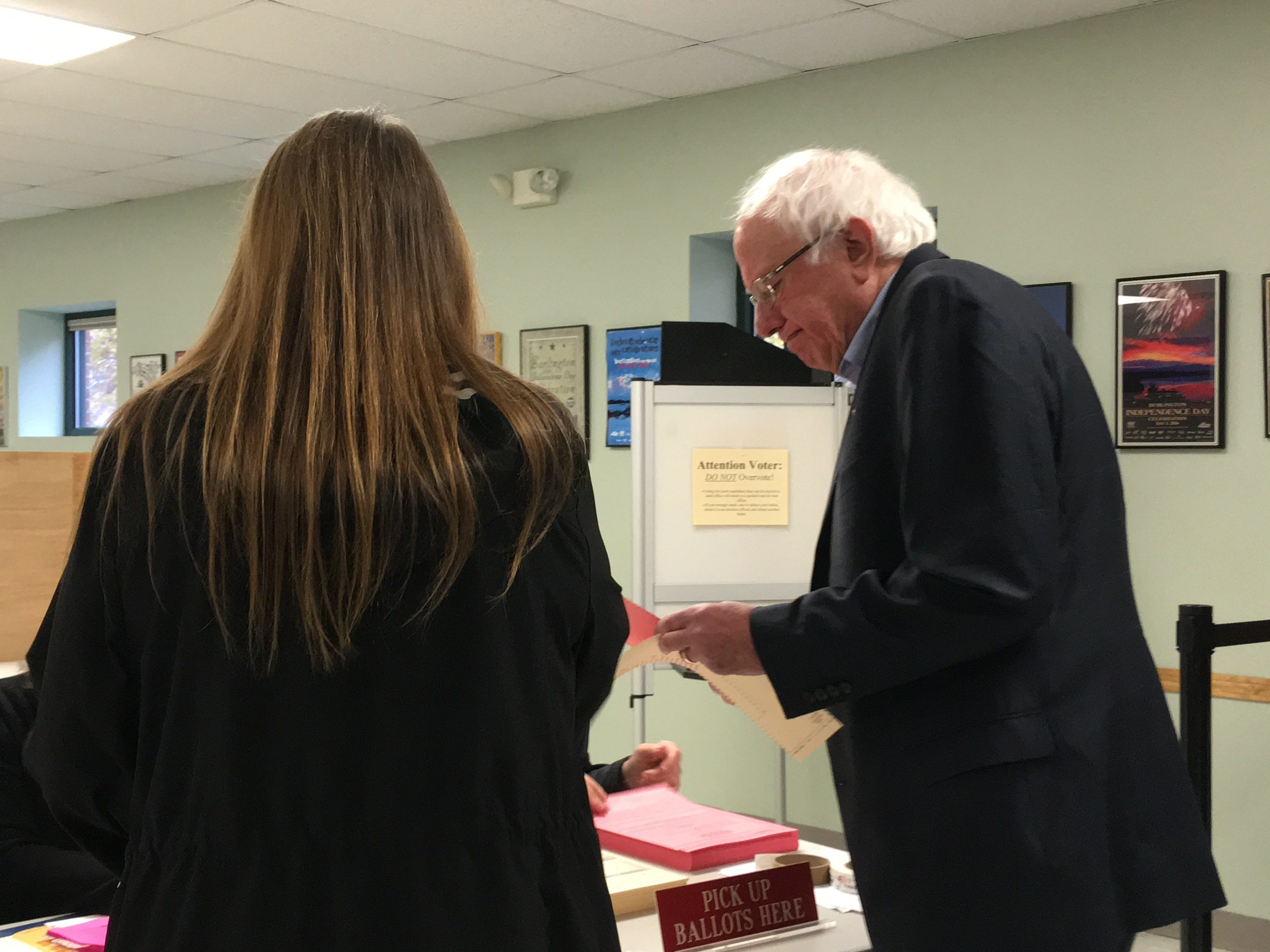Sen. Bernie Sanders and his wife, Jane O'Meara Sanders, get ready to vote at the Burlington Ward 7 polling station at the Robert Miller Community and Recreation Center on Tuesday, Nov. 6, 2018.
