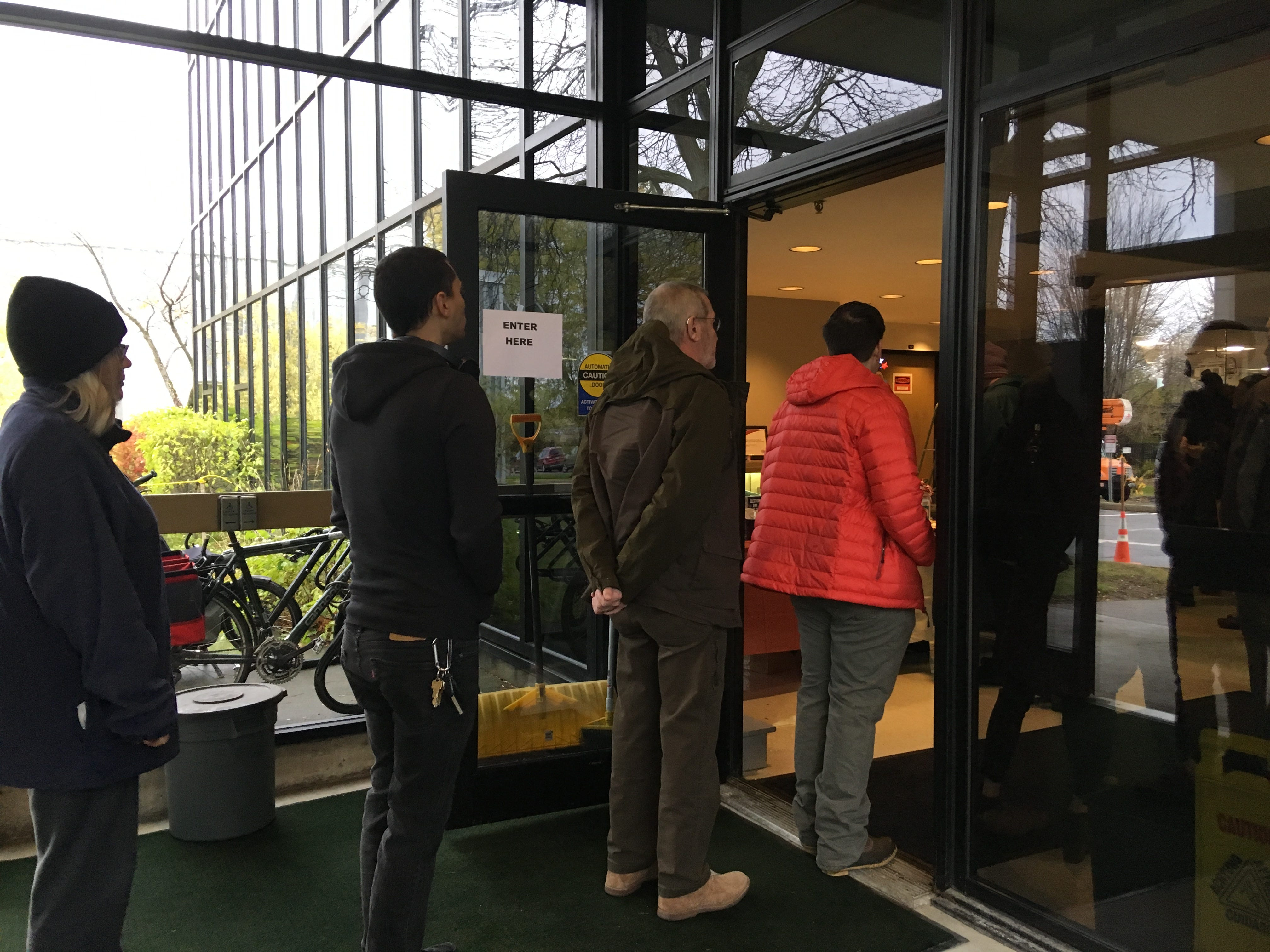 Burlington voters flock to the Ward 5 polling station at Burlington Electric Department around 8:30 a.m. on Tuesday, Nov. 6, 2018. The elections inspector said it's busier than usual.