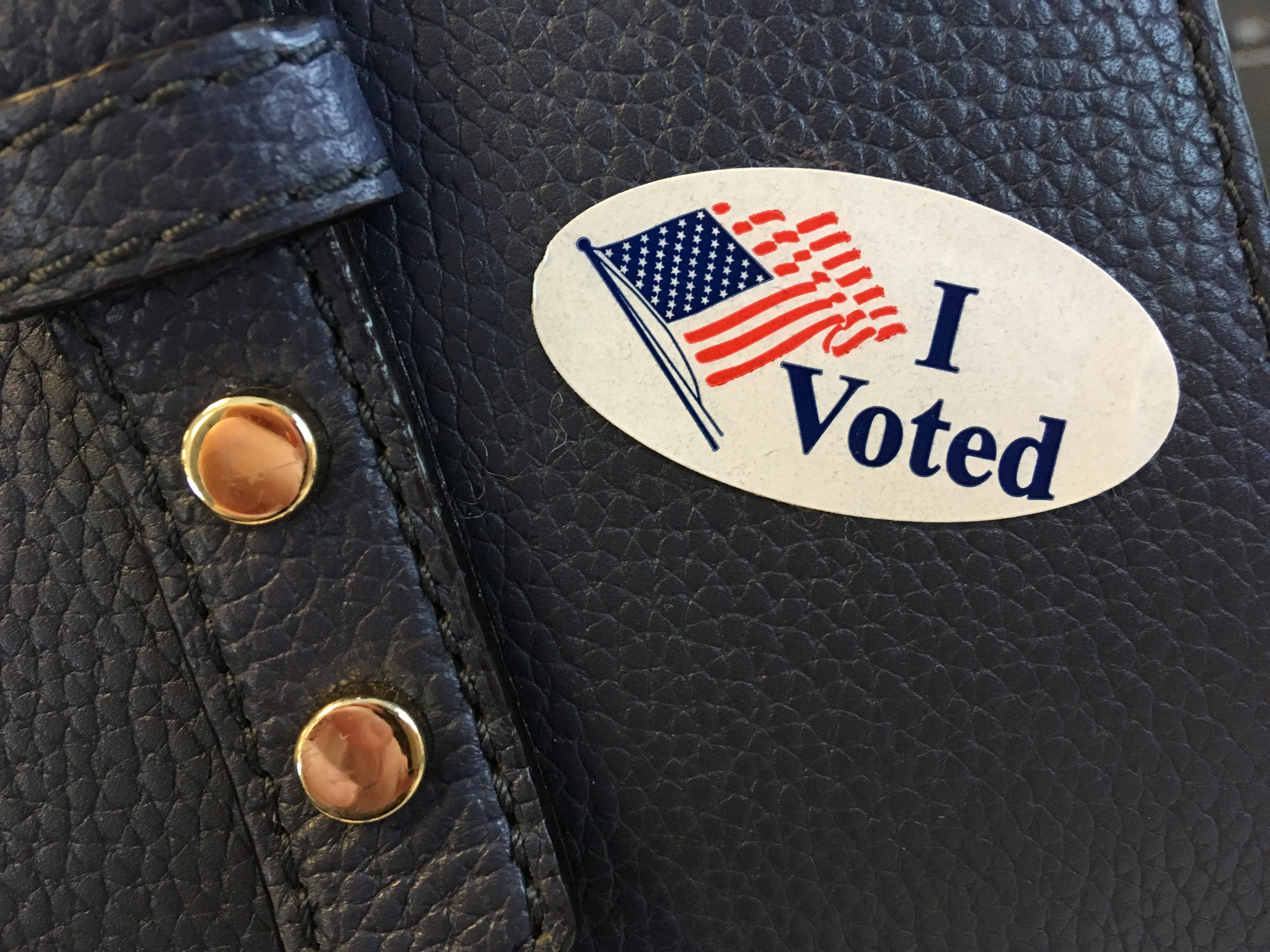 This sticker, handed out after ballots have been cast at polling stations, is the key to a cup of free coffee in Burlington, Vermont, on Tuesday, Nov. 6, 2018.