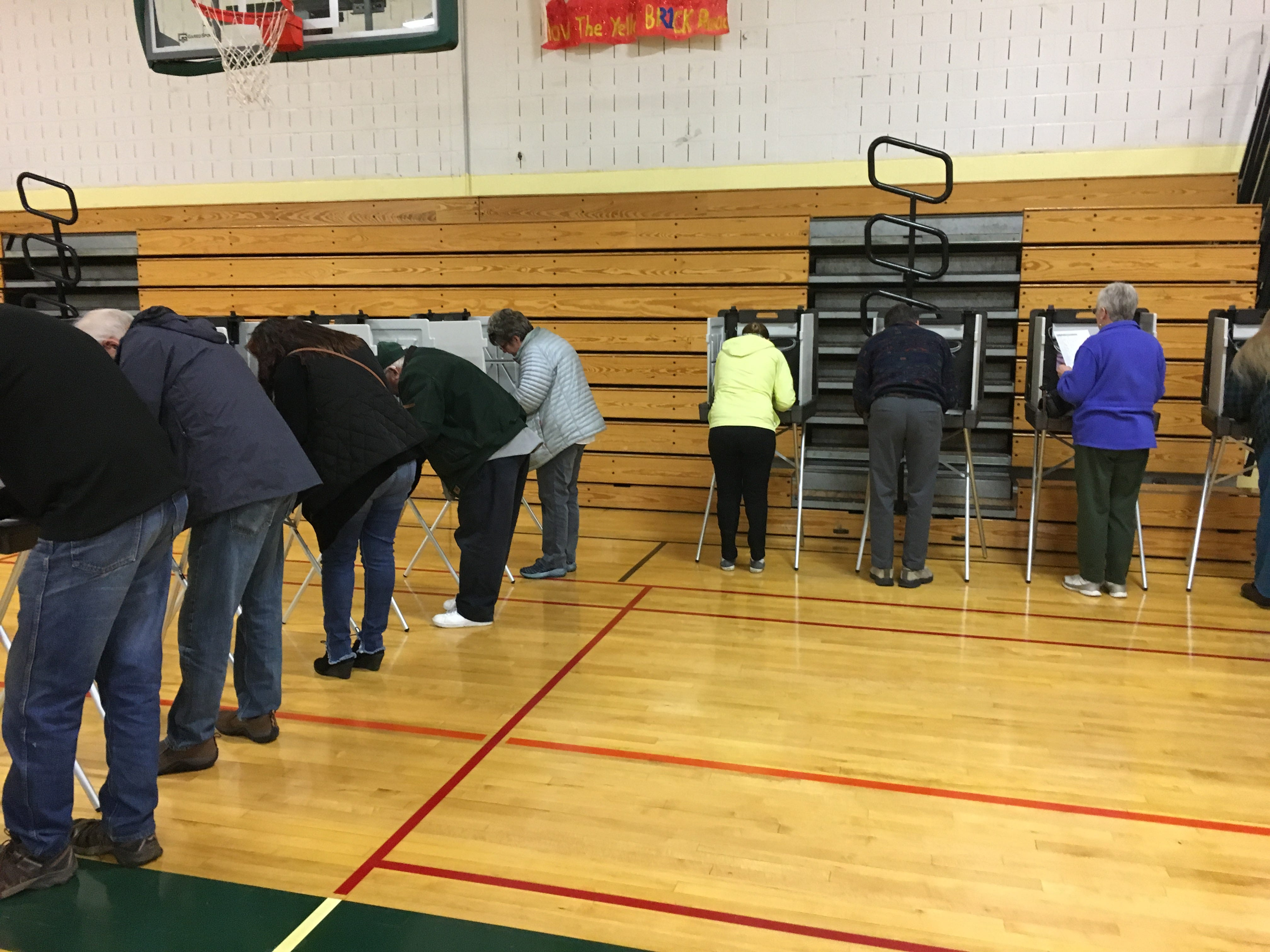 Residents cast their ballot at the polling location at Colchester High School in Colchester, Vermont, on Tuesday, Nov. 6, 2018.