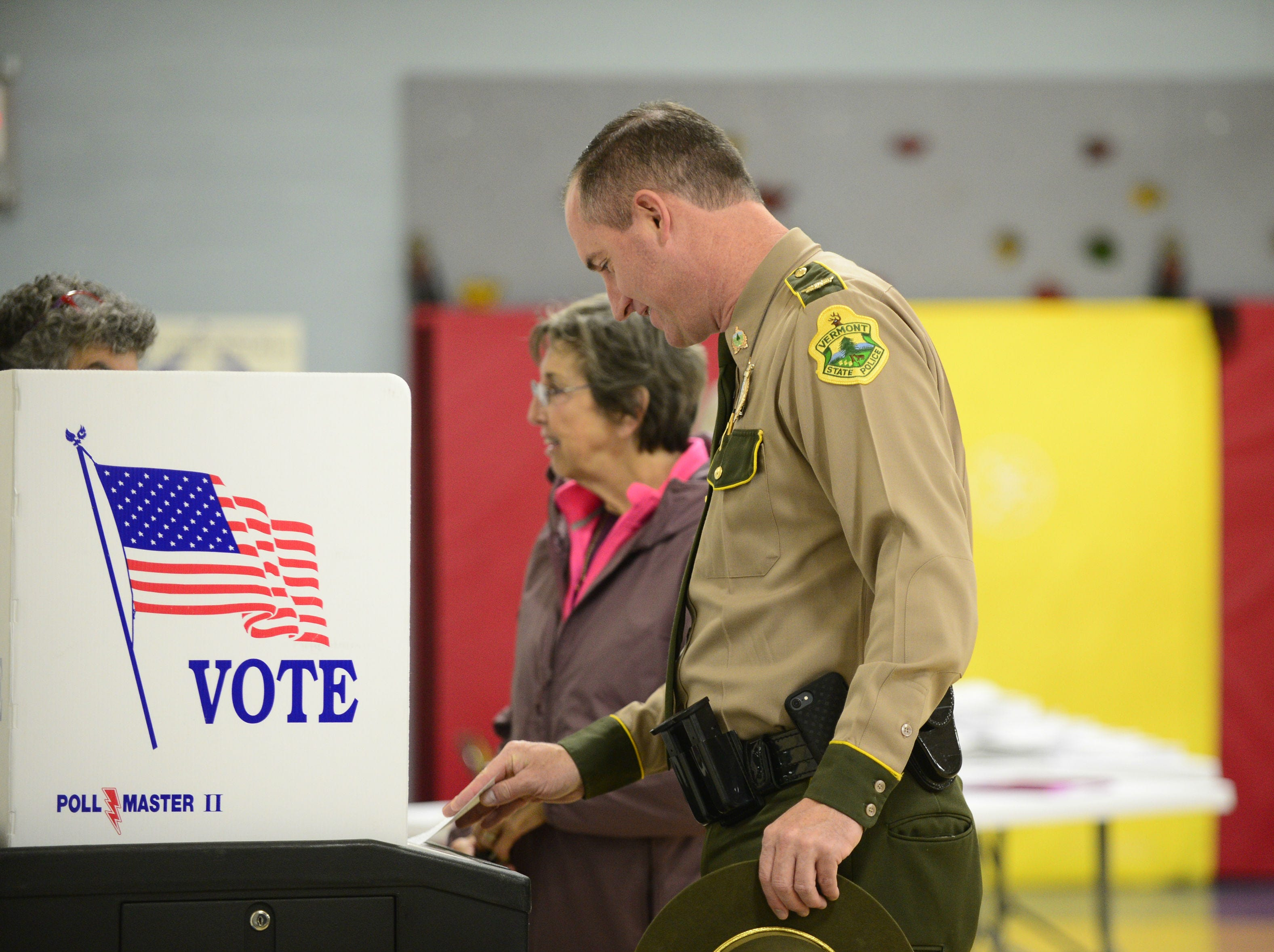 Col. Matthew Birmingham, director of the Vermont State Police, casts his ballot on Nov. 6, 2018, in the gym at Orchard School in South Burlington