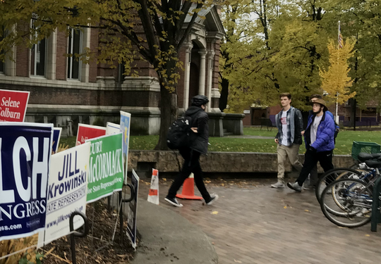 University of Vermont students (from right) Nick Mologne, David Sileo and Simon Carruthers arrive the polls for same-day voter registration at Fletcher Free Library in Burlington on Tuesday, Nov. 6, 2018.
