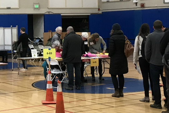 Ward 6 Voters line up to vote at Edmunds Middle School on Tuesday, Nov. 6, 2018.