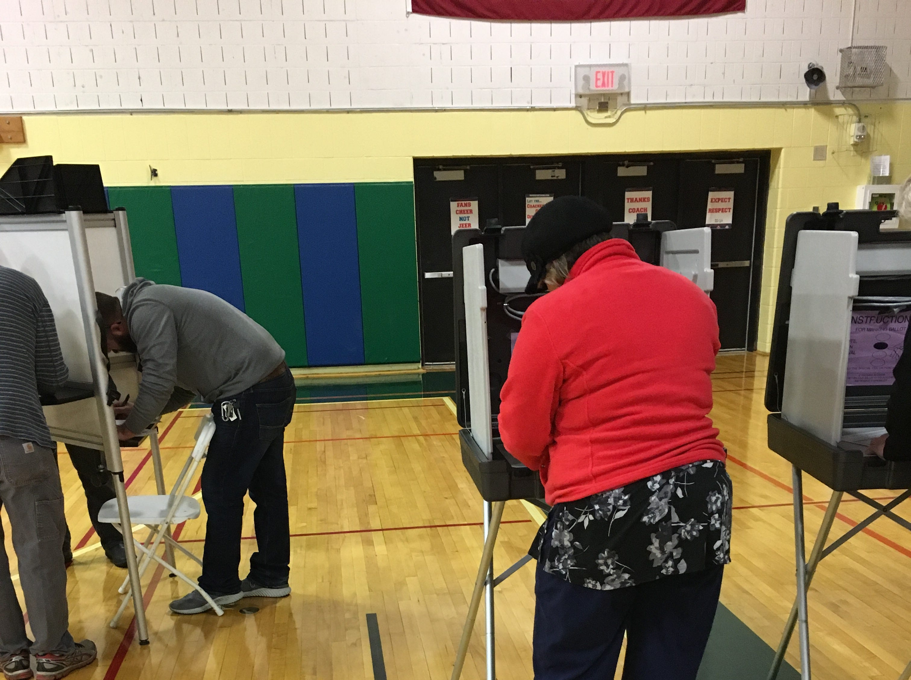 Resident casts their ballot at the polling location at Colchester High School in Colchester, Vermont, on Tuesday, Nov. 6, 2018.