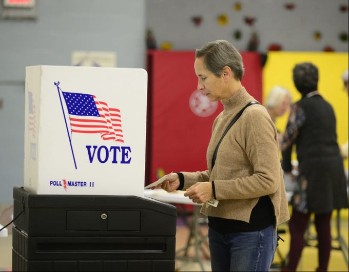 Patricia Tobias, of South Burlington, casts her ballot on Nov. 6, 2018, at the Orchard School in South Burlington.