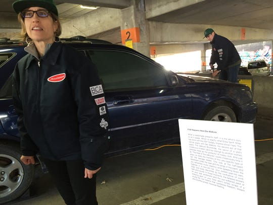 """Martha Whitfield leads a tour while University of Vermont student Nolan Joyce provides special effects at """"AutoBiography,"""" a performance-art piece at the Marketplace Parking Garage in Burlington on Sunday, Nov. 4, 2018."""