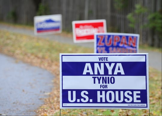 Campaign signs dot the lawn of the Orchard School, a South Burlington polling station, on Nov. 6, 2018.
