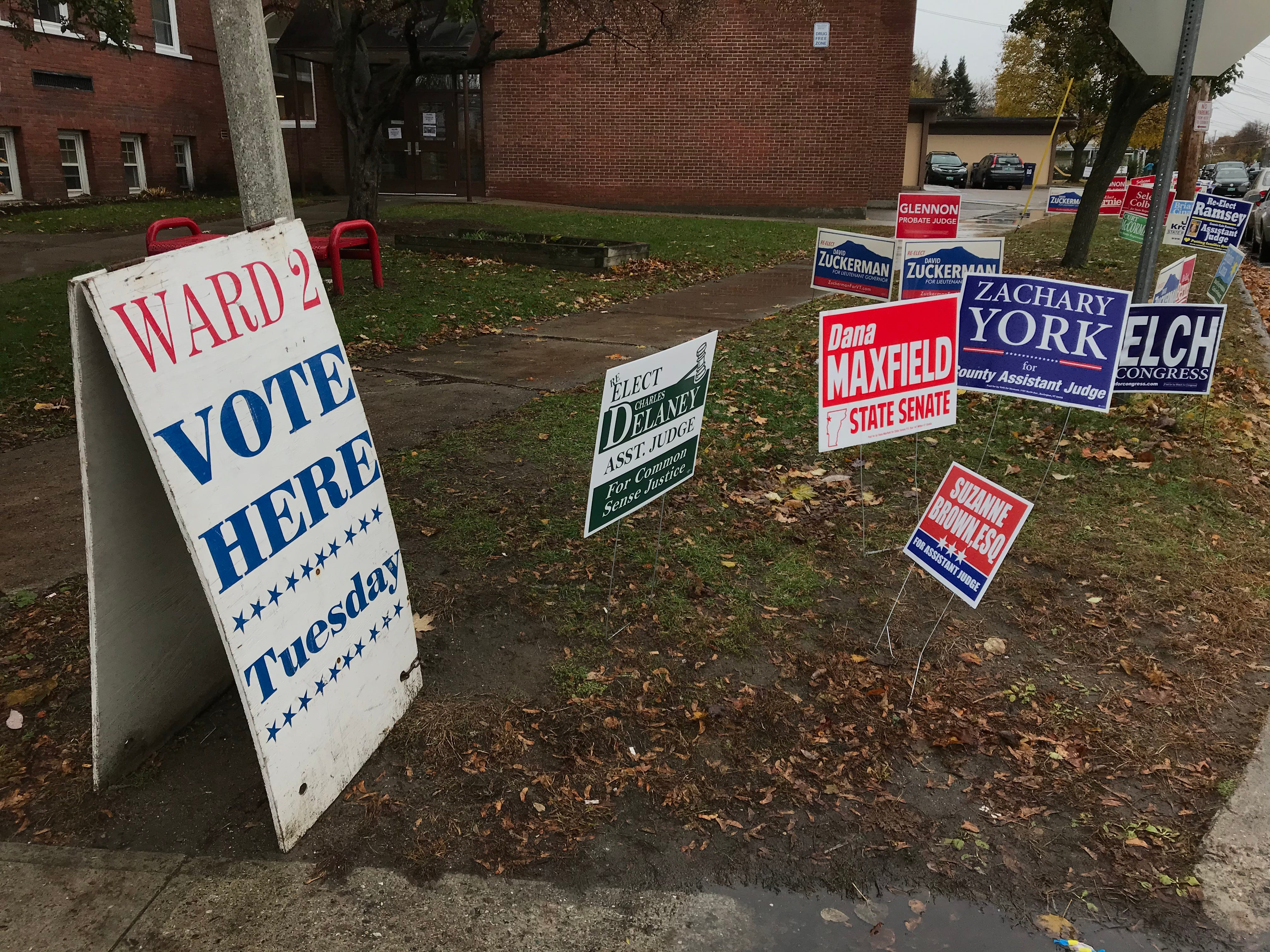 Political signage marks the entrance of H.O. Wheeler School, at 6 Archibald St. in Burlington, where Ward 2 residents vote on Tuesday, Nov. 6, 2018.