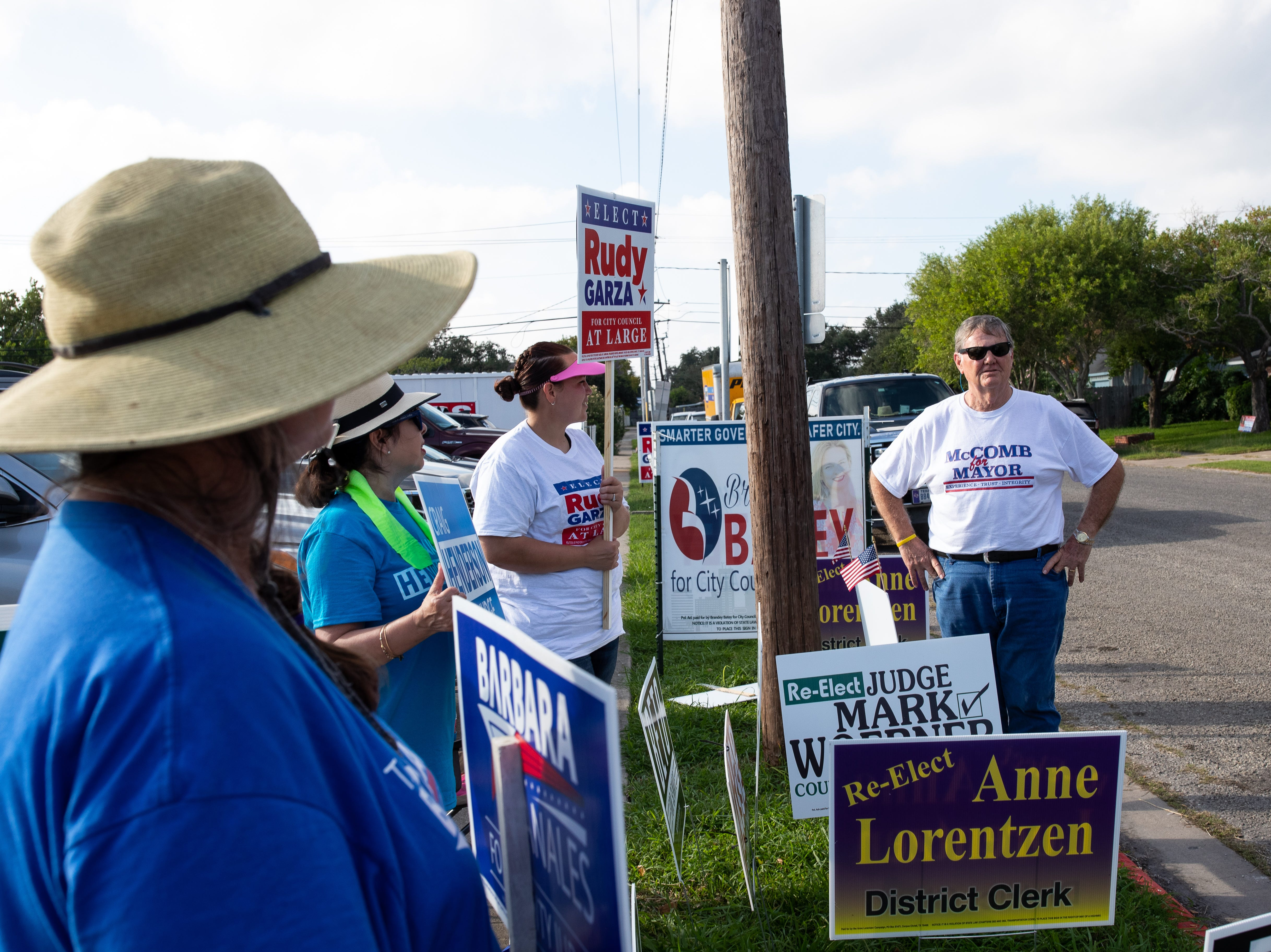 Corpus Christi Mayor Joe McComb  (far right) makes a campaign stop outside the Montclair Elementary School polling location during Election Day on Tuesday, Nov. 6, 2018.