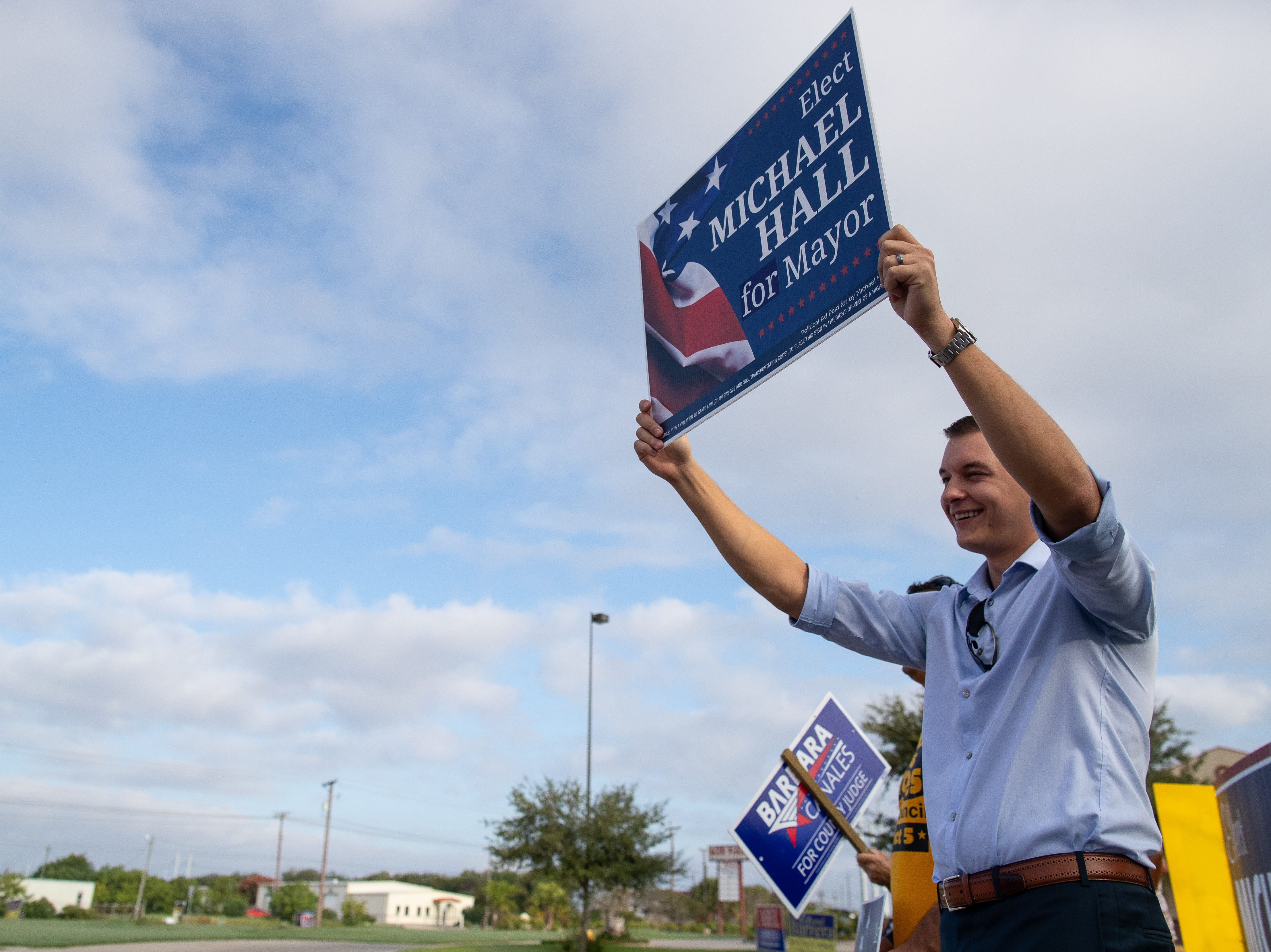 Corpus Christi mayoral candidate Michael Hall campaigns outside the Valencia polling location on Tuesday, Nov. 6, 2018.