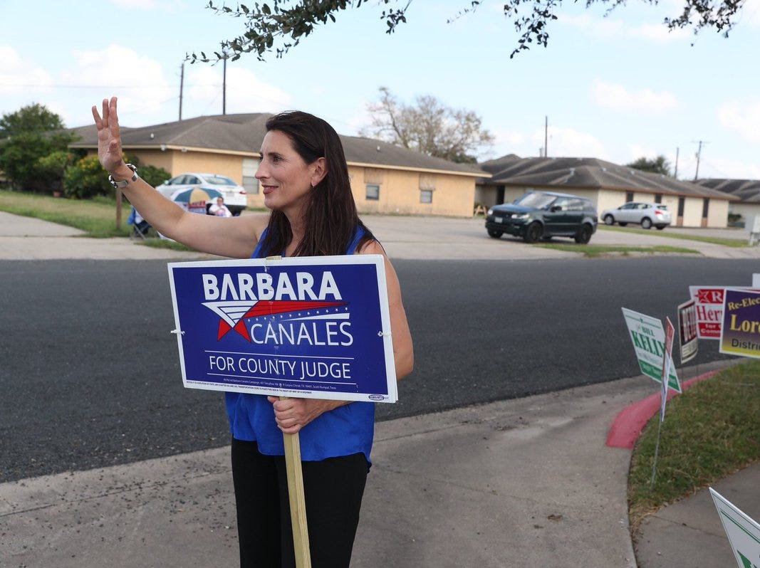 Democrat Barbara Canales campaigns outside a polling location in the Calallen area on Tuesday, Nov. 6, 2018.
