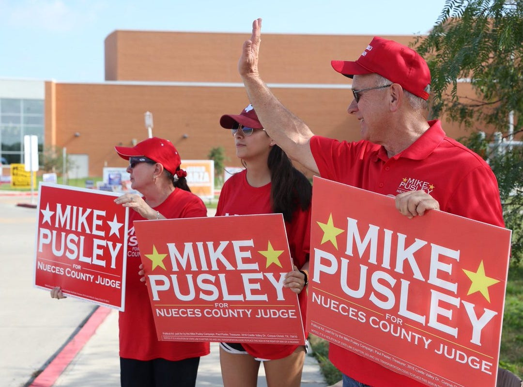Doralisa Reyna (left), Alissa Cervantes and Republican Mike Pusley campaign outside Veterans Memorial High School on Tuesday, Nov. 6, 2018.