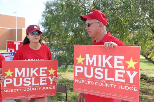 Alissa Cervantes (left) and Republican Mike Pusley campaign outside Veterans Memorial High School on Tuesday, Nov. 6, 2018.