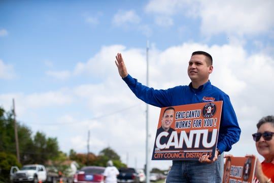 District 3 Council candidate Eric Cantu campaigns outside the Moody High School polling location during election day on Tuesday, Nov. 6, 2018.