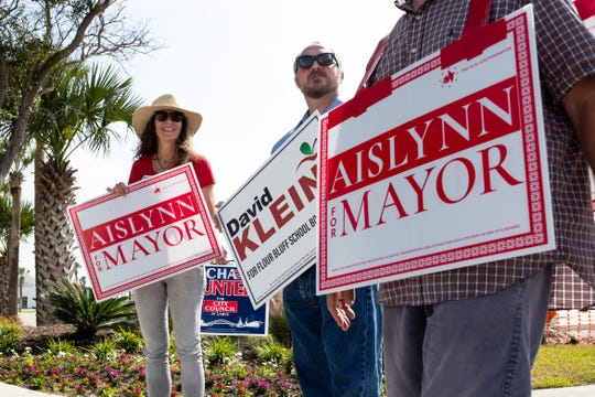 Corpus Christi mayoral candidate Aislynn Campbell campaigns outside the Schlitterbahn polling location on Tuesday, Nov. 6, 2018.