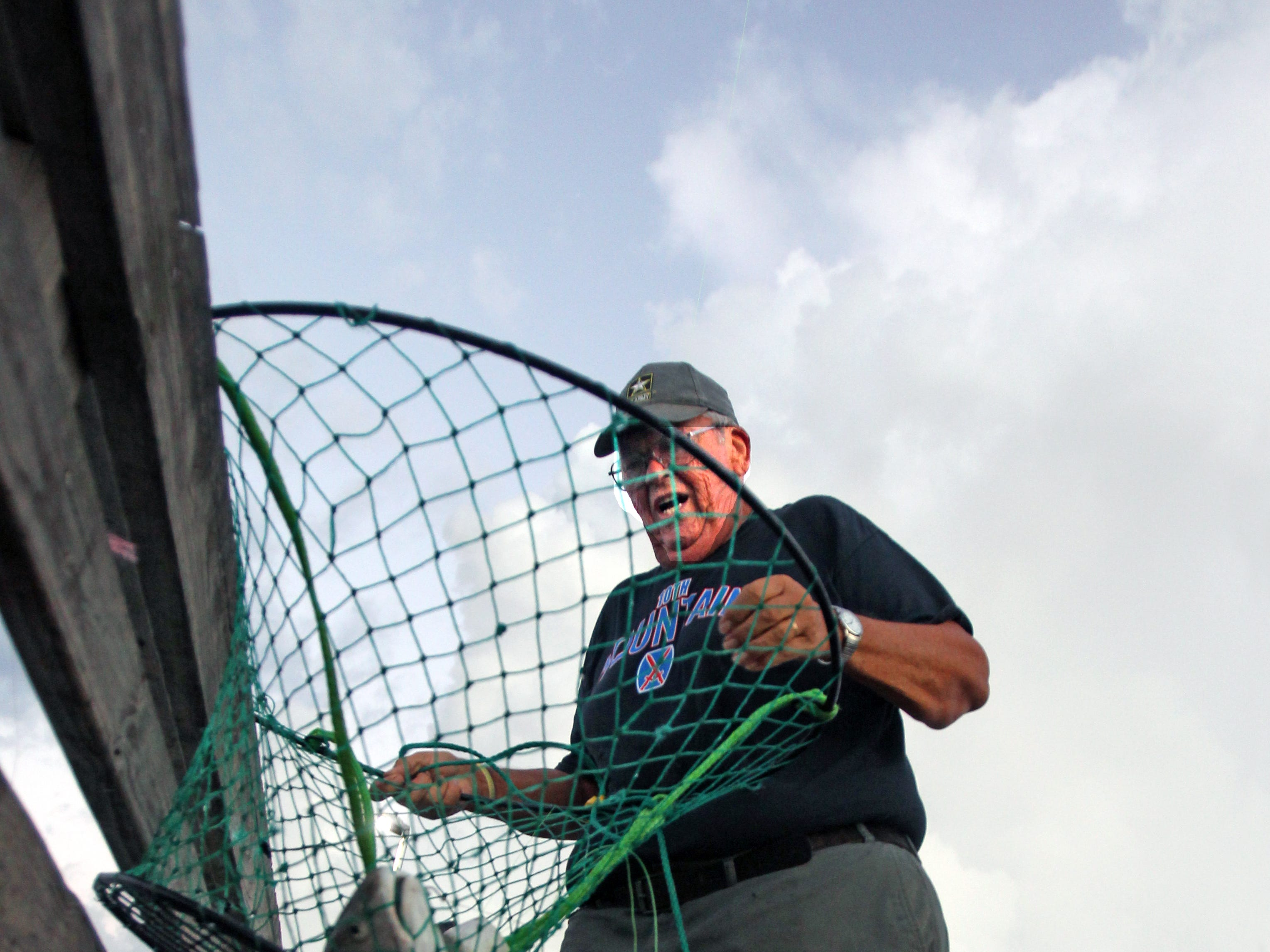 Lloyd Niederriter is always willing to help fellow anglers land a fish with his hoop net.