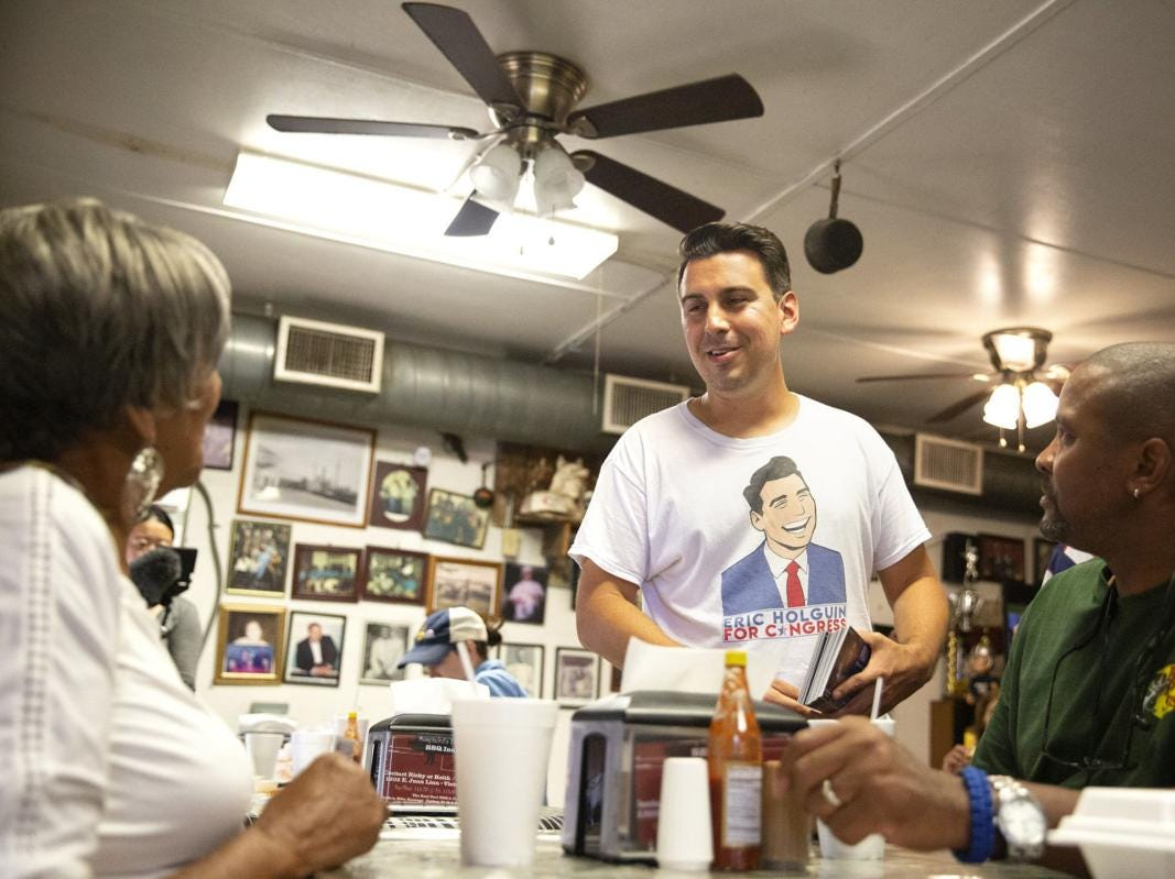 Democratic candidate Eric Holguin visits with prospective voters Joyce Bell and Fred Spears at Mumphord's Place Bar-B-Q Tuesday. Holguin is challenging incumbent Michael Cloud for the District 27 seat.