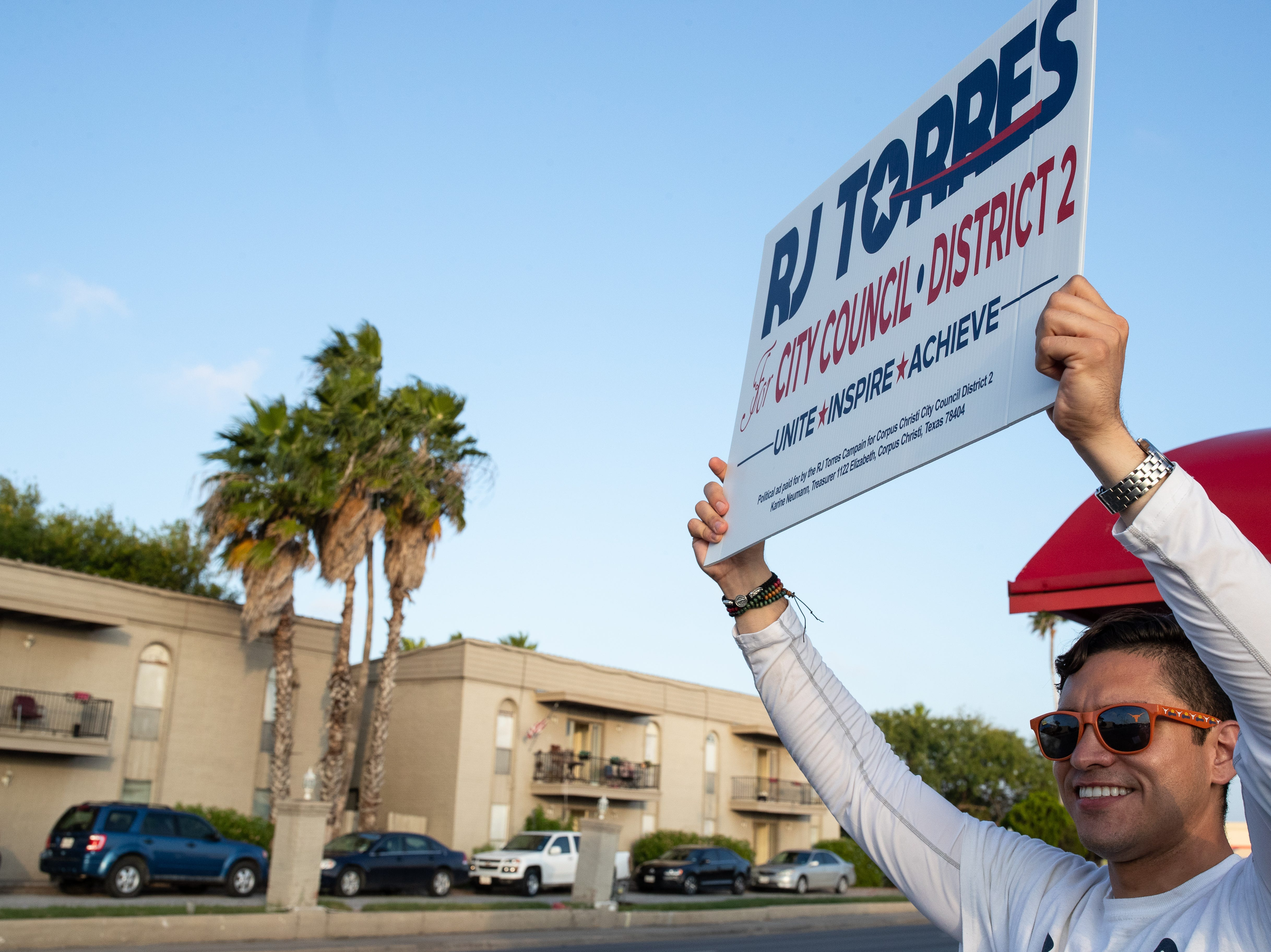 Candidate for Corpus Christi's City Council District 2 seat, RJ Torres campaigns outside the Deaf and Hard of Hearing Center during election day on Tuesday, Nov. 6, 2018.