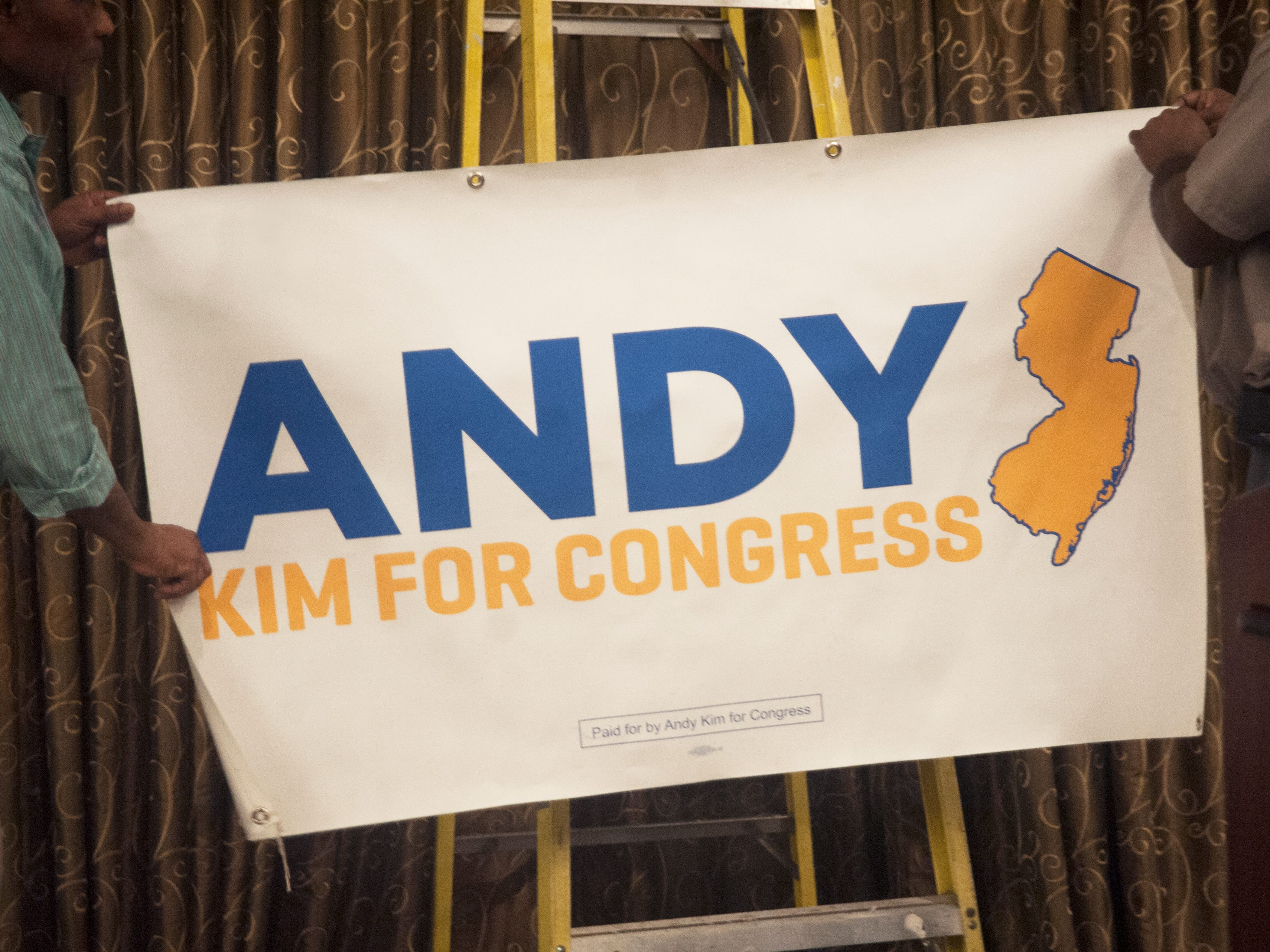A banner is hung in a ballroom of the Westin Mount Laurel, the election night headquarters for Democratic 3rd Congressional District candidate Andy Kim on Tuesday, November 6, 2018.